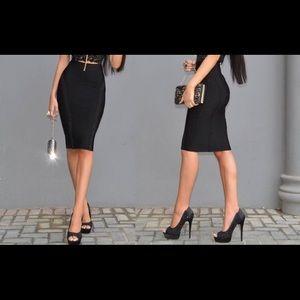 Like new black Bebe midi pencil skirt